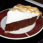Bev's Chocolate Pie - Sweet and creamy, this chocolaty pie is topped with a meringue, and baked until the filling is set and the billowy topping is tinged with gold.