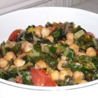 Swiss Chard with Garbanzo Beans and Fresh Tomatoes - Beans and greens are a perfect combination; earthy and satisfying. This recipe for Swiss chard with garbanzo beans, onion, and fresh tomato is brightened with lemon juice and makes a perfect vegetarian main dish or a tantalizing side dish for fish or meat.