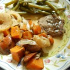 Pork Chops with Apples, Onions, and Sweet Potatoes - A perfect medley of flavors! The sweetness of the apples and brown sugar are a perfect complement to succulent pork chops.