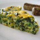 Crustless Spinach Quiche - A quick and easy crustless spinach quiche recipe that uses eggs, spinach, onion, and Muenster cheese for the perfect quiche in less than an hour.