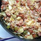 Cabbage Jambalaya - An easy recipe that will have the kids eating cabbage like it's going out of style! Ground beef and sausage are simmered together with tomatoes, onion, celery, cabbage and rice.