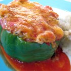 Stuffed Green Peppers I - Green bell peppers stuffed with ground beef, rice, and sharp Cheddar cheese are a hearty meal perfect for weeknight dinners.
