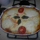 Pasta Lasagna - Penne baked with ground beef, tomato sauce, ricotta, mozzarella, Parmesan and an egg.