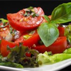 Summer Tomato Salad - This recipe is great ending to a hot summer day. It is a family recipe passed down to me from my great grandmother. My grandmother and I use to sit outside with candles all around us with this salad and warm conversation. The original recipe was first used in 1912.