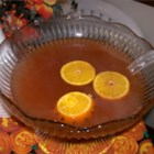 Warm and Spicy Autumn Punch - The aroma of this punch tells you that autumn is in the air. Hot apple cider is sweetened with pineapple juice and honey, and spiced with clove-studded oranges, cinnamon, and nutmeg.