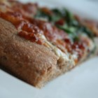 Whole Wheat and Honey Pizza Dough - Want to make your pizza dough, but don't have time for it to rise?  This is a quick and easy recipe for you!  Just combine whole wheat flour, yeast, wheat germ, salt and honey, bake, and then top with your favorite toppings.