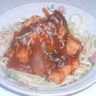 Quick Chicken Zingarella - Tender chicken breasts are cooked with sauteed mushrooms, onions and garlic, then simmered in spaghetti sauce, red wine and a sweet dose of brown sugar. Roasted red peppers finish the sauce, which is served over boiled linguini.