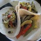 Vegan Fajitas - Zucchini, yellow squash, bell peppers and onion are marinated and then sauteed.  Serve with tortillas or rice, if desired.