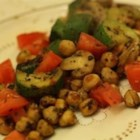 Garbanzo Stir-Fry - Fresh herbs are sauteed with garlic in olive oil, then cooked with garbanzo beans, zucchini, mushrooms and tomatoes. This can be served either as a main dish or side dish. If you like, you can add raisins or pine nuts to the garbanzos in the beginning.