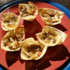Won Ton Wrapper Appetizers - Cheesy sausage-based filling in little cups made from baked won ton wrappers. The  baked cups and filling may be prepared a day or two in advance (store covered in the refrigerator) and assembled shortly before serving.
