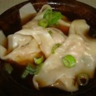 Homemade Wonton Soup - Pork wontons simmer in chicken broth with Chinese vegetables in this hearty and warming soup.
