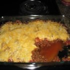 Taco Bake I - Browned ground beef mixed with dried taco seasoning is layered in a casserole with canned refried beans and salsa. It is topped with shredded Monterey Jack cheese and baked for 20 to 25 minutes.