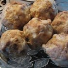 Plum Dumplings - Fresh prune plums are filled with a spoonful of sugar, then rolled into a soft potato dough, boiled until tender, and rolled in buttery crumbs for a traditional Macedonian treat.