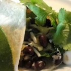 Squash and Zucchini Burritos - Shredded zucchini and summer squash team up with black beans to make a savory filling for easy baked tortillas. They are flavored with prepared green salsa and red bell pepper, and get a topping of melted Mexican-style cheese.