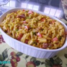 Bohemian Macaroni and Cheese - Embellish a box of macaroni and cheese with bell pepper, onion, tomato and crumbled bacon, then make it extra special by baking a crispy crust on top.