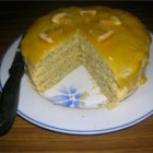 Poppy Seed Torte with Orange Glaze - This moist orange poppy seed cake is made up of four layers, filled and frosted with buttercream, and topped with an orange glaze. Beautiful and delicious!