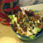 Delicious Apple Salad - Fresh and dried fruits are dressed in sour cream in this salad which can be served with turkey or ham, or as a dessert.
