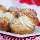 Cream Puffs - Homemade cream puffs will wow your guests, but they are so easy to make, especially if you fill them with instant vanilla pudding. The baked puff shells are a simple alchemy of milk, butter, water, salt and eggs. Presto!
