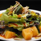 Avocado and Cantaloupe Salad with Creamy French Dressing - Avocado and cantaloupe top arugula leaves in this tangy salad drizzled with a cider vinaigrette.