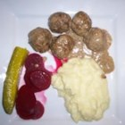 Finnish Meatballs (Lihapyorykoita) - Try these Finnish meatballs seasoned with allspice and served in a creamy gravy!