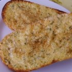 Roasted Garlic Bread - A very easy recipe for garlic bread that is made with roasted garlic, butter and Parmesan cheese.