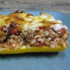 Cheese and Sausage Stuffed Zucchini - Zucchini stuffed with sausage, three cheeses and diced tomatoes.  A delicious combination.