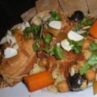 Slow Cooker Moroccan Chicken - Chicken is slow cooked with tomatoes, apricots, peaches, garbanzo beans, and spices to create an aromatic and spicy sauce. Serve with couscous or rice.