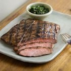 Flank Steak Marinade - Light brown sugar and honey are blended with soy sauce, garlic, and green onion to make a savory sweet marinade for flank steak.