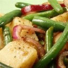 Warm Green Bean and Potato Salad with Goat Cheese - A delicious salad of green beans, potatoes, red peppers, and goat cheese goes perfectly with chicken or pork. Experiment with other potato types such as purple and other soft cheeses, such as garlic and herb.