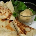 Bazlama - Turkish Flat Bread - This simple flatbread gets its tang from yogurt. It's best served warm.