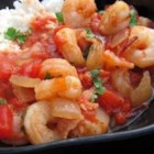 Island Shrimp and Rice - Shrimp, rice, and seasonings come together nicely in this great recipe. It's like a jambalaya. The secret is the bacon!