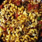 Mexican Pasta - Pasta tossed with a quickly cooked sauce of tomatoes, onion, bell pepper, corn, black beans, salsa and taco seasoning.