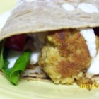 Falafel I - Chickpeas pureed with garlic, peanut butter, onions, egg, soy sauce and spices, then formed and fried.  Excellent when served in a pita with sliced tomato, cucumber and yogurt.