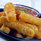 Fried Mozzarella Cheese Sticks - Mozzarella sticks are coated in a simple batter and quickly deep fried to golden perfection. Try dipping them in a marinara sauce!