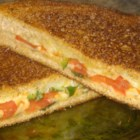 Grilled Cheese with Tomato, Peppers and Basil - Classic grilled cheese sandwiches with a kick.  Delicious!  These are great with a bowl of tomato soup with a little basil added.
