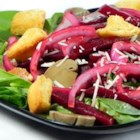 Nicole's Balsamic Beet and Fresh Spinach Salad - Beets and onions are marinated in an aged balsamic dressing and served on fresh spinach leaves.