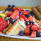 Patriotic French Toast - French toast topped with sweetened cream cheese, strawberries, and blueberries. Start your 4th of July with a red, white, and blue breakfast!