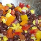 Black Bean and Corn Salsa - Canned black beans mix with yellow, orange, and green bell pepper in a simple vinegar and olive oil dressing to make this salsa.