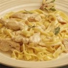 Slow Cooker Chicken Alfredo - Try this recipe for super easy chicken made with tasty Alfredo sauce, Swiss cheese and Parmesan cheese. It is very good served over egg noodles or rice.