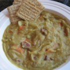 Split Pea Soup - This is a hearty pea soup in which dried split peas and a ham bone are cooked with carrots, potatoes, onions and a pinch of marjoram.