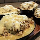 Stuffed Acorn Squash Supreme - Acorn squash is partially cooked in the microwave, then filled with turkey sausage, broccoli, cheese, rice, and apples.