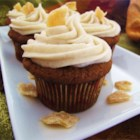 Pumpkin Ginger Cupcakes - Delicious, light and fluffy! These taste of Fall, and the crystallized ginger gives then a lovely little zing. Even people who don't like pumpkin love these cupcakes. These disappear as fast as I can set them out!