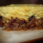 Slow Cooker Tamale Pie - Brown some ground beef and place it into a slow cooker with beans and seasonings, then spoon some corn bread mix topping over the beef, set the cooker, and come home to a tamale pie dinner.