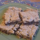 Davy Crockett Cookies - A yummy bar cookie that combines oatmeal, chocolate chips, brown sugar, and white sugar.