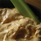 Chicken Wing Dip - This spicy baked dip tastes just like hot chicken wings, but without the mess.  It is very addicting, and is perfect for football and tailgating season. Serve with tortilla chips. I take this whenever I have to bring a dish and am always asked for the recipe.