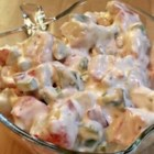 Imitation Crabmeat Salad - Imitation crab, onion, bell pepper and celery are tossed with an Italian sour cream mayonnaise dressing and chilled to blend the flavors.