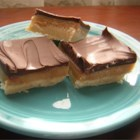 Caramel Shortbread Squares - These cookies consist of a shortbread crust, firm caramel center, and a milk chocolate top. They are super-easy to make and they take only 20 minutes to bake.