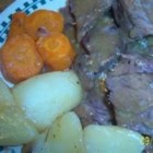 Pot Roast in Beer - The flavor of this hearty rendition is boosted by the addition of sauteed onion, celery and garlic before braising. Bay leaves and cloves are also used.