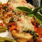 Deborah's Grilled Chicken - Chicken breasts are flattened and grilled with a savory tomato-basil topping and Parmesan cheese.