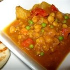 Broken Thermostat Curry - This flavorful, vegetarian curry is made with carrot, yam, red potatoes, tomatoes, and cauliflower.